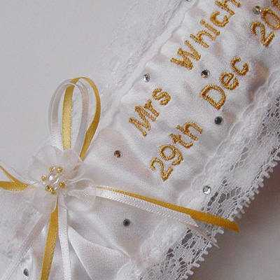 Couture wedding garter with embroidery and ribbons in Cadbury purple, sixpence bag and crystals as extras...